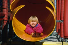 A boy on a playground; Size=240 pixels wide